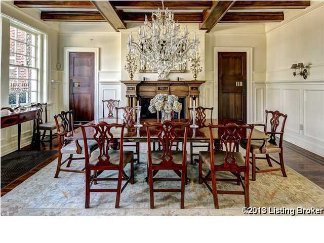 The dining room has an antique, elegant feel and seats 8.