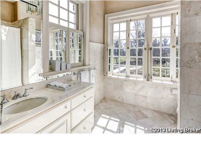 The bathroom has beautiful window giving the space plenty of natural light.