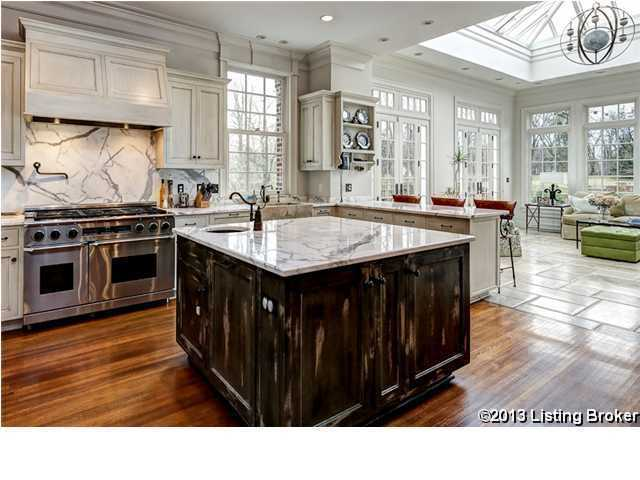 Granite topped island and back splash, rustic cabinetry, and modern appliances. Simply beautiful.