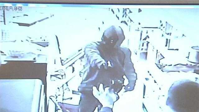 Terrifying moments for a convenience store clerk were caught on camera.