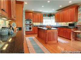 Spacious kitchen featuring wooden cabinets and a custom designed island.