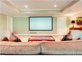 Entertainment room complete with space for a large TV and TV Unit.