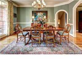 Dining room features tasteful antique furniture.
