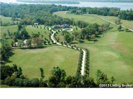 Aerial of the property shows the 4 bedroom, 6 bathroom home and stable. For more information on this property, check out Realtor.com.