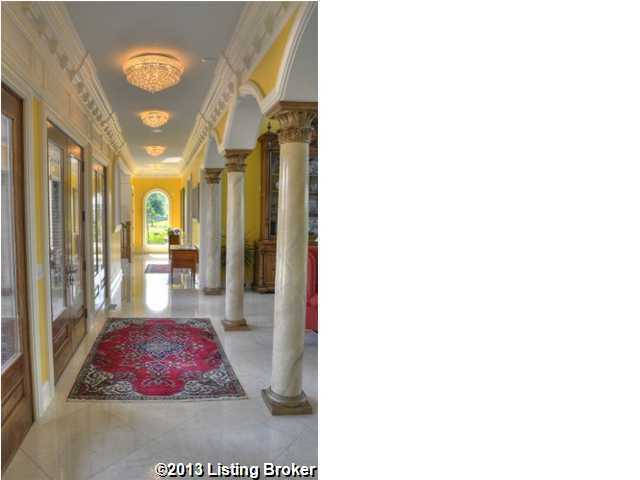 Marble columns compliment the antique decor of this hallway.