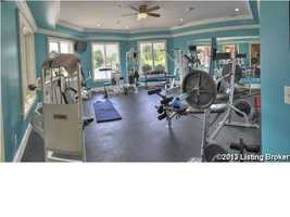 Indoor gym is filled with a diverse selection of equipment.