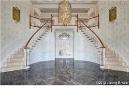 This foyer may take your breath away, between the amazing chandelier and grand staircase that crawls up both sides of the second story. In total, this home has 10 bathrooms and 6 bedrooms.