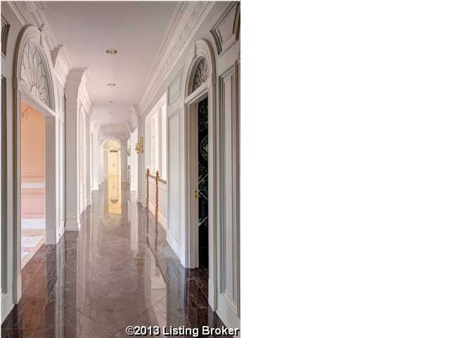 Hallway is topped with marble and aligned by beautiful archways.