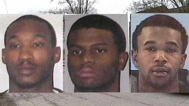 Three men are accused of forcing their way into a woman's minivan and holding her at gunpoint before beating her in the head with their weapons.