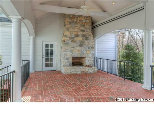Outdoor fireplace behind the veranda.