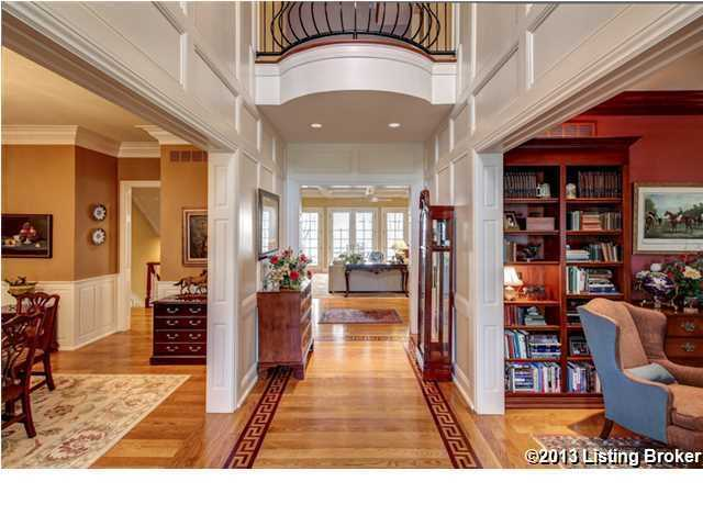Foyer opens up into a wide open floor plan showing the living room, formal dining room and second story.