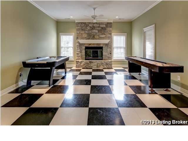 Playful marble tiles lets you know you're in the game room. The basement of this home  is wide enough to be used for multiple purposes.  But if you like what you and want more information about this property, visit Realtor.com.