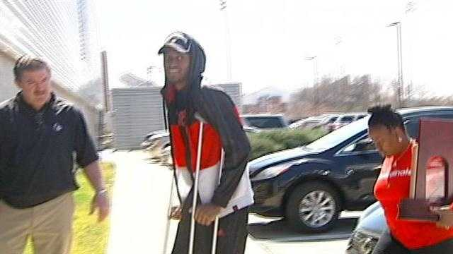 ware on crutches at uofl.jpg