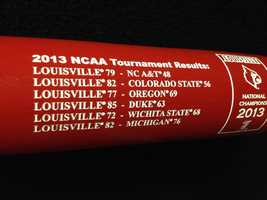 On the back are the scores of every Louisville game from the NCAA 2013 Tournament.