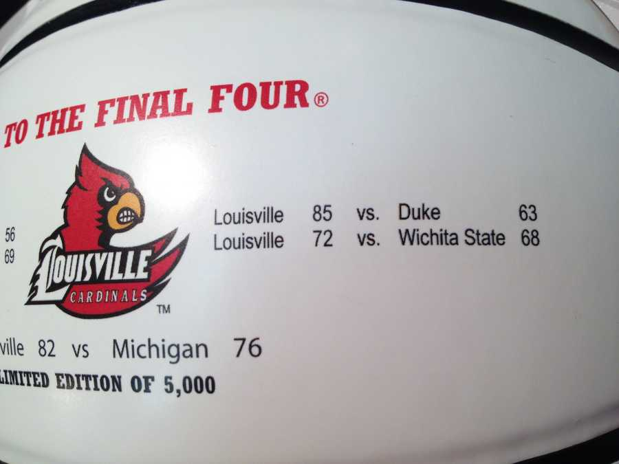 """The ball contains the official school logo and NCAA Final Four logo, and has 3 white panels. All the scores of EVERY Cards game are listed, along with the phrase """"National Champions."""""""