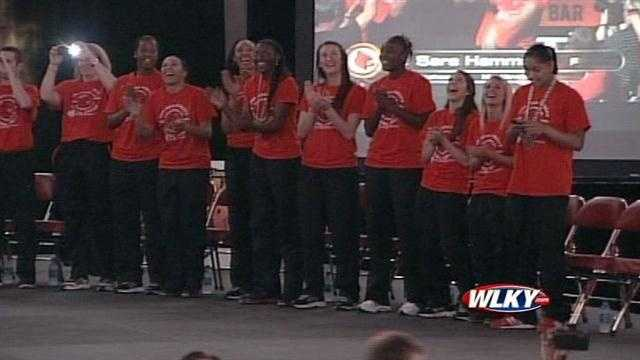 The Louisville Lady Cardinals are introduced to fans at a basketball celebration at the KFC Yum Center.