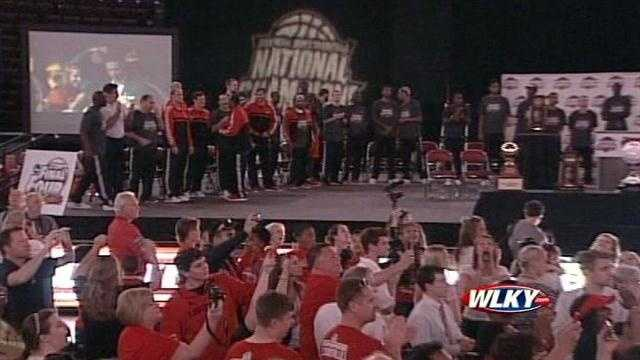 The National Champions Louisville Cardinals are introduced to fans at a basketball celebration at the KFC Yum Center.