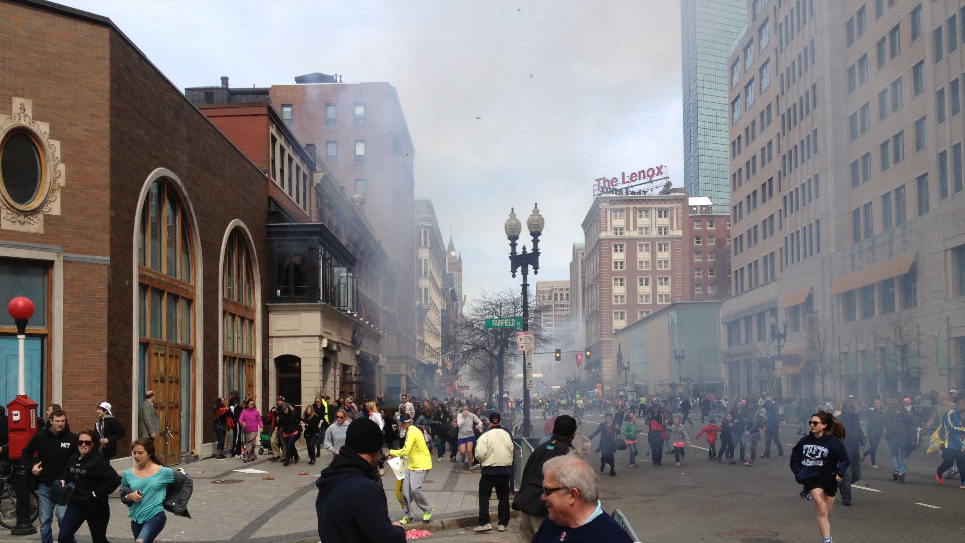 You can see Dzhokhar A. Tsarnaev on the left near the building