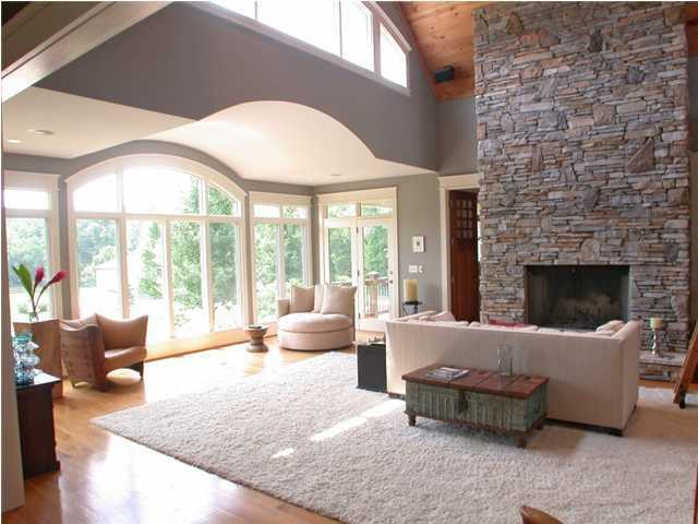 The living room features a beautiful stone fireplace.