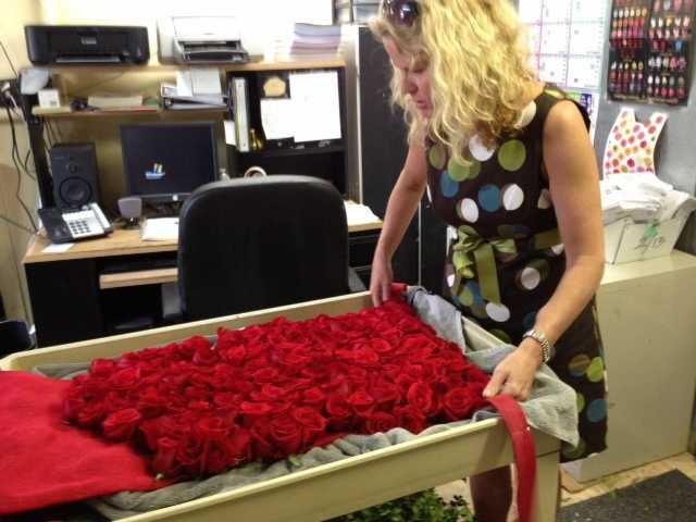 The dress is made of 250 roses and weighs in at 40 pounds.Photos courtesy of Vest Advertising, Marketing and Public Relations
