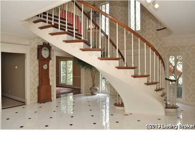 The front doors open right in front of the charming staircase.