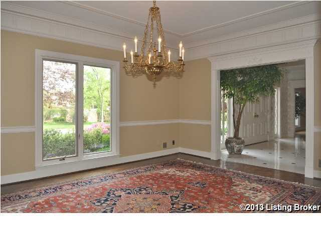 To the right of the entrance is the dining room, which features a gorgeous candle-lit chandelier.