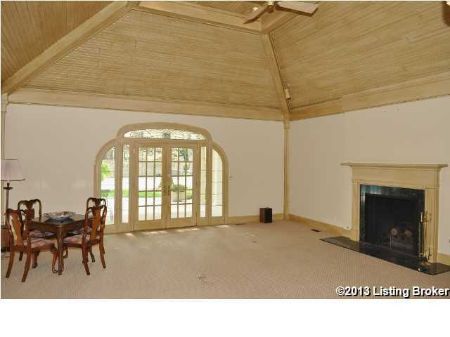 Vaulted ceiling and a fireplace in this family room space.