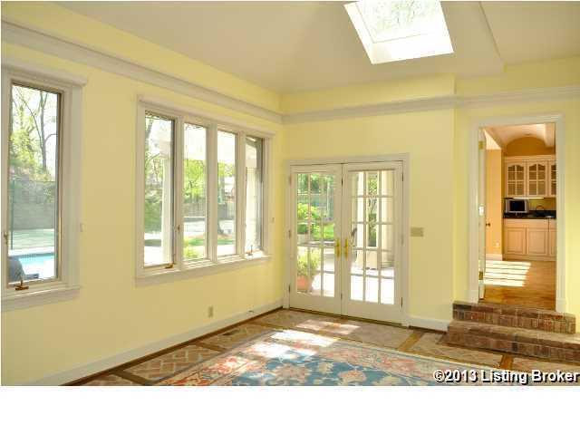 The kitchen steps down into this quaint sun-room.