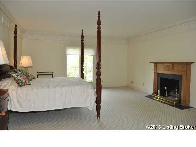 Master bedroom. This is one of 4 bedrooms in the home. It also has a fireplace.