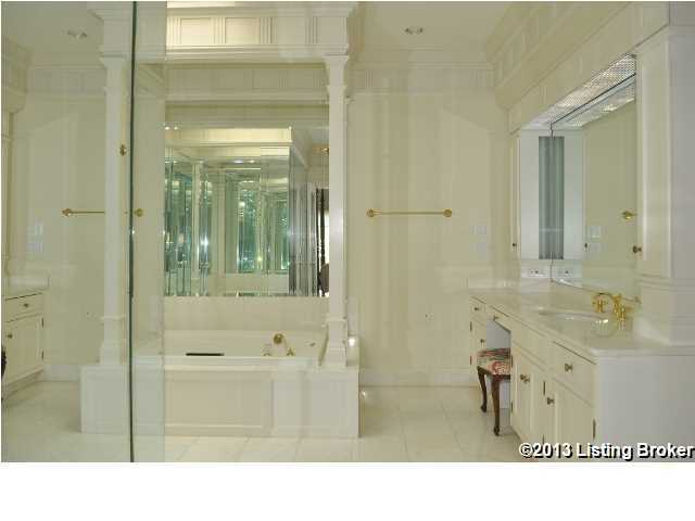 Master bathroom features a classic spa tub and separate shower space.