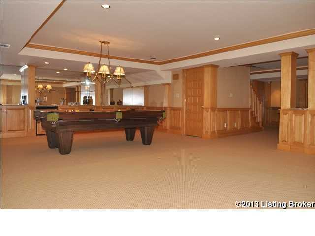 Entertainment room featuring a wet bar and pool table.