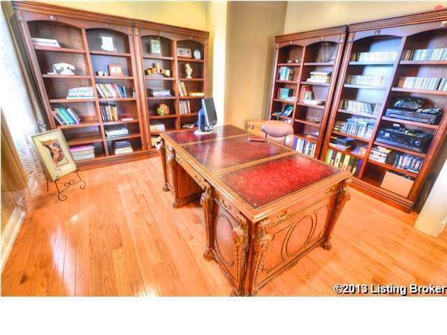 Home office features custom bookcases.