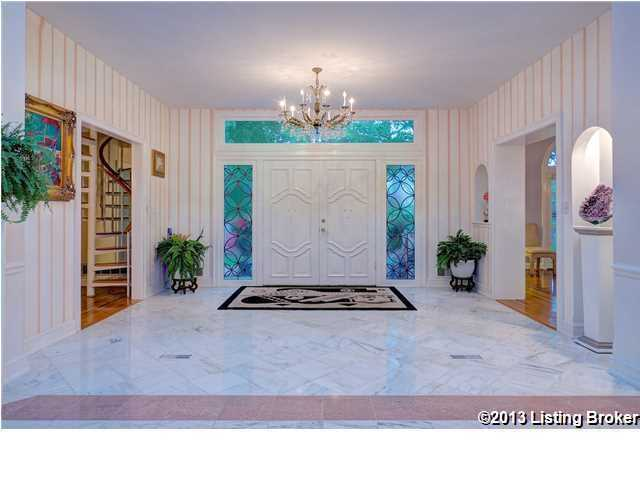 Bright white foyer with artistic accents.