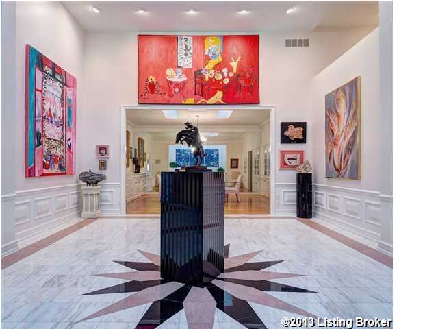 The home displays exquisite art pieces in this gallery space adjacent to the foyer.