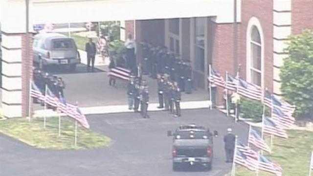 officer ellis body arrives at church.jpg