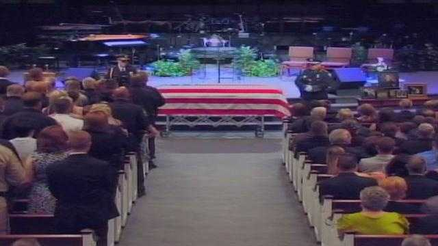 May 30, 2013:Mourners packed Parkway Baptist Church to pay their last respects to Officer Ellis.