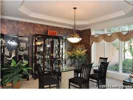 Just to the left of the foyer, you'll find the formal dining room.