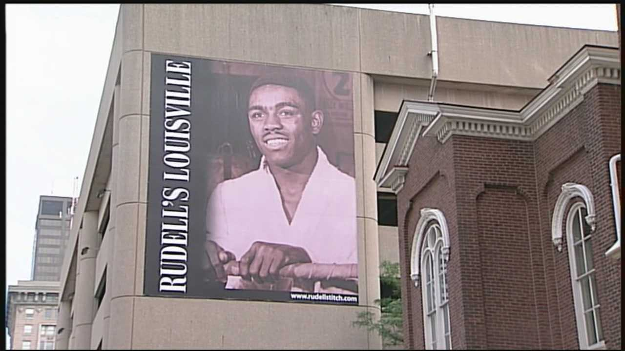 On Wednesday, the Louisville Pride Foundation unveiled a banner of Rudell Stitch on the Fourth Street Live parking garage.