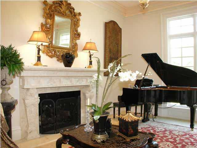 Formal sitting area features it's own marble fireplace and piano.