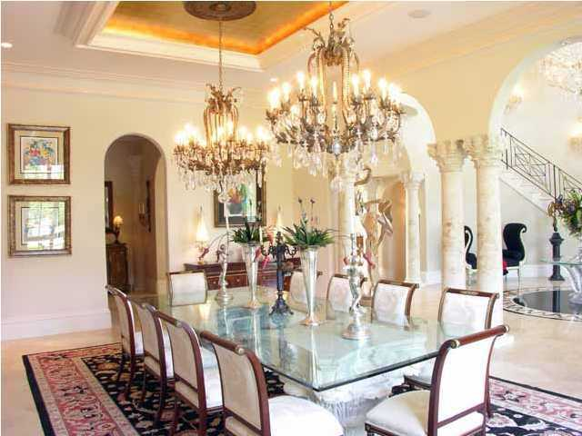 Formal dining room is covered by a golden ceiling as well, adding a sense of elegance.