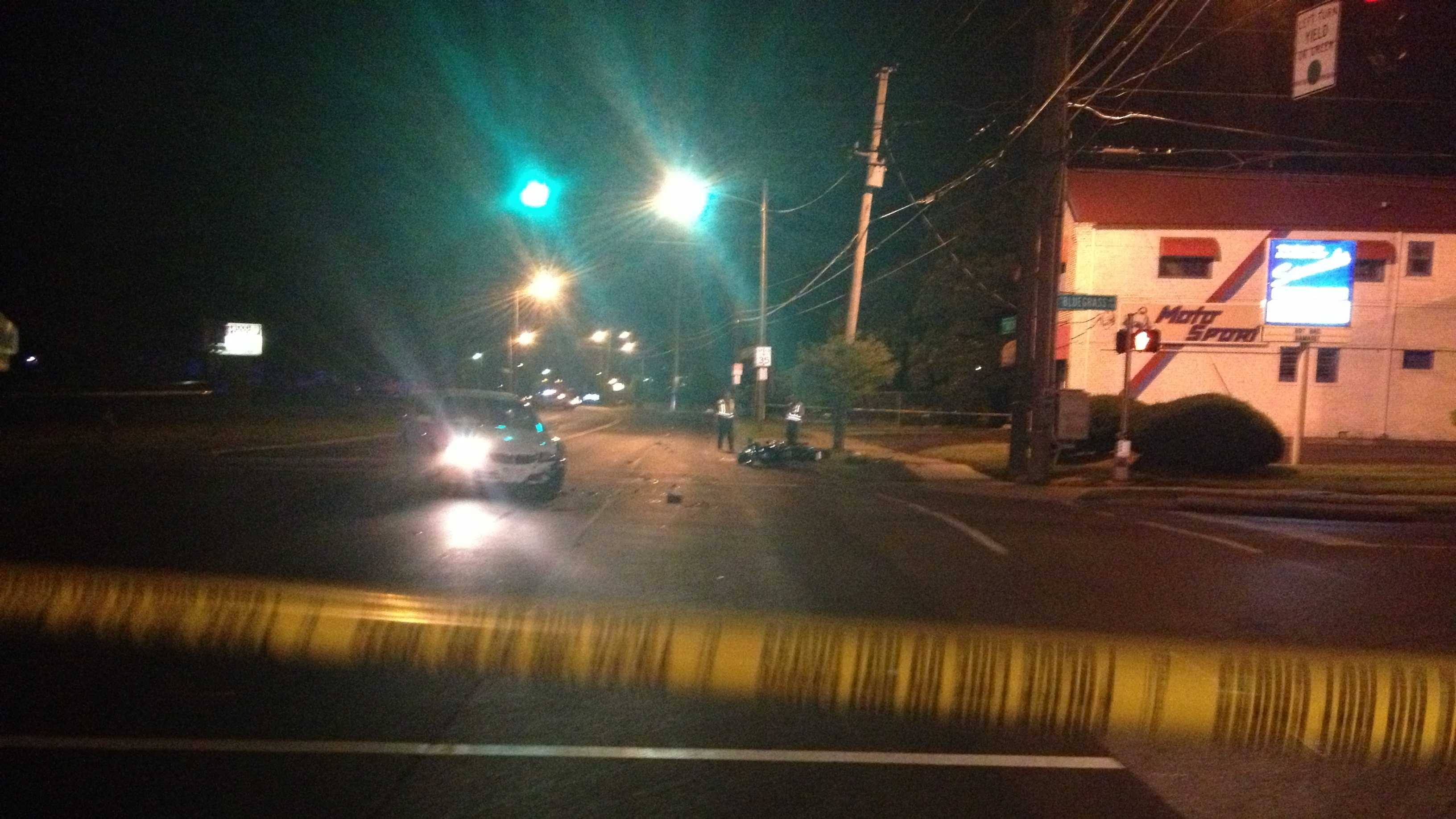 A woman was killed after the motorcycle she was riding on was hit by a car.