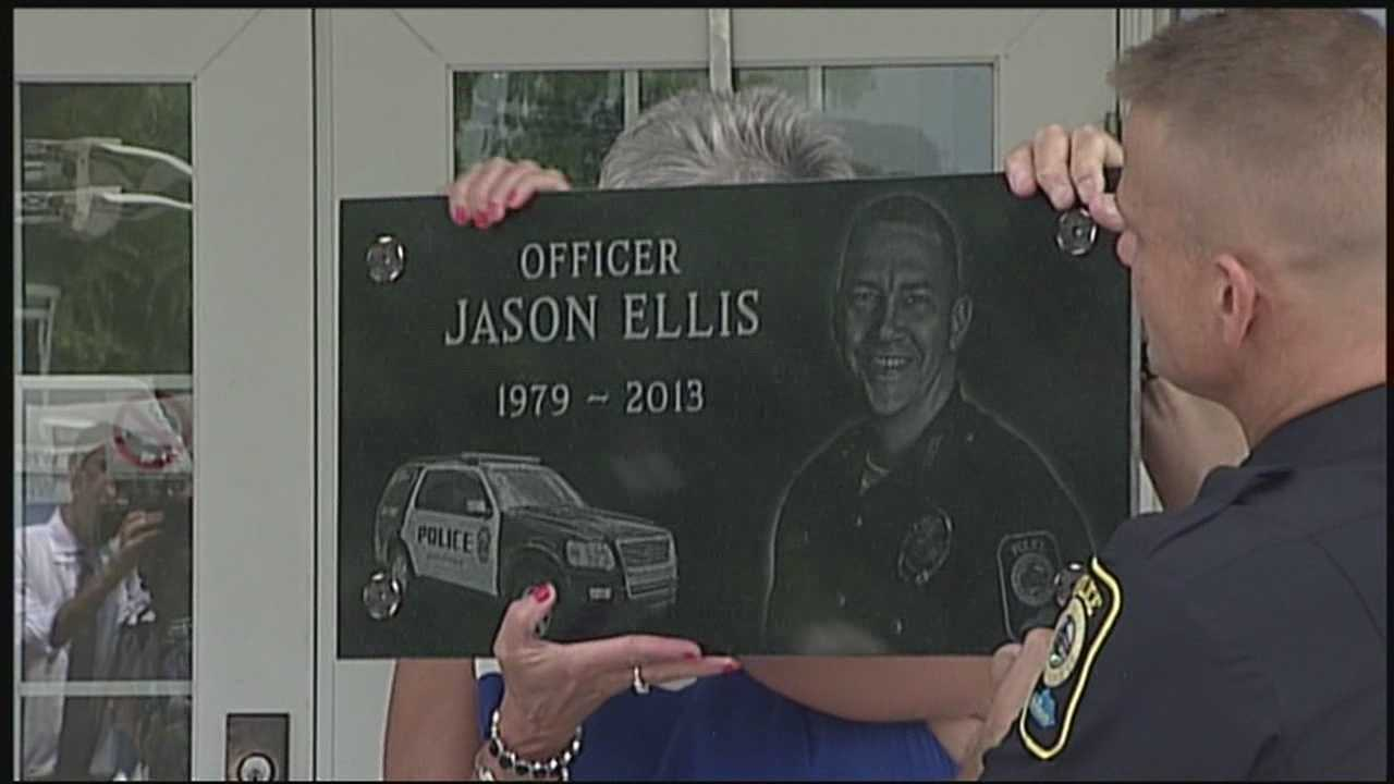 A memorial plaque is dedicated in honor of fallen Bardstown Police Officer Jason Ellis.