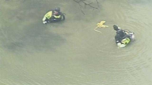 June 27, 2013:Police returned to the scene where Officer Jason Ellis was killed. The Louisville Metro Police Department dive team searched a nearby pond after a K-9 unit indicated there might be something there.