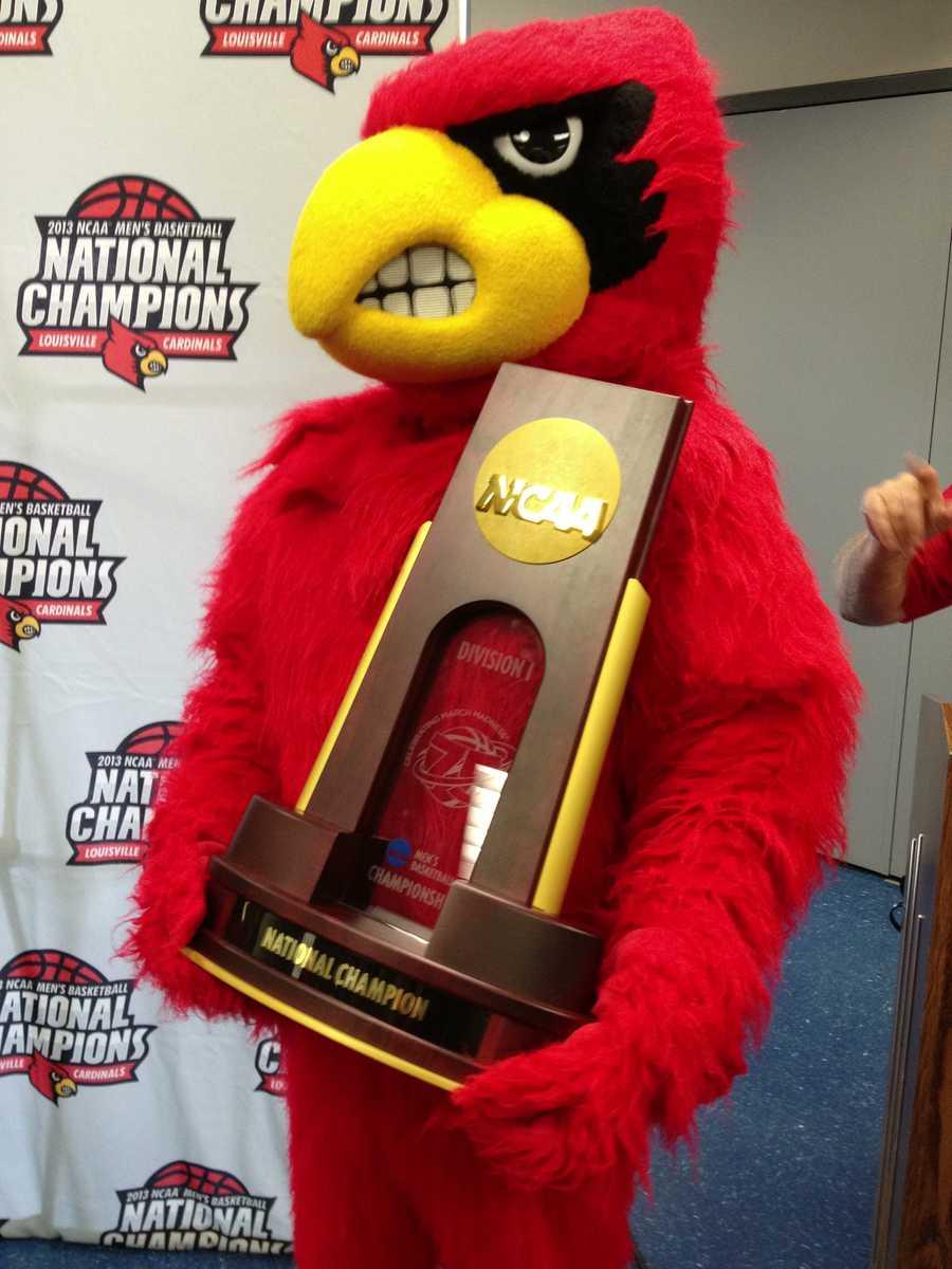Cardinal bird with title trophy