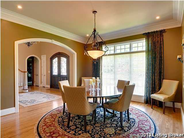 Family dining rooms aren't always about the glam. This peaceful space overlooking the beautiful landscape is a perfect place to come together for a family dinner.