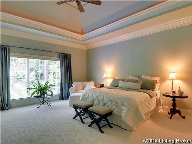 Alternate view shows off the huge windows and vaulted ceilings in this expansive suite.