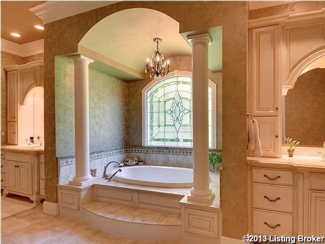 Master bathroom is not only peaceful, but also elegant. This view of the bathroom focuses on the extravagant, dual pillar, bathing quarters.