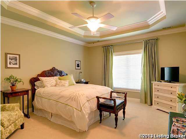 This beautiful bedroom is on the second floor and is one of the remaining 4 bedrooms in the home. It also features moulded, vaulted ceilings and a floor-to- ceiling window.