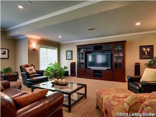 Masculine leather couches indicate this may be the man cave.