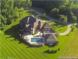 Aerial view shows just how majestic this property truly is. For more information on this home, visit Realtor.com.